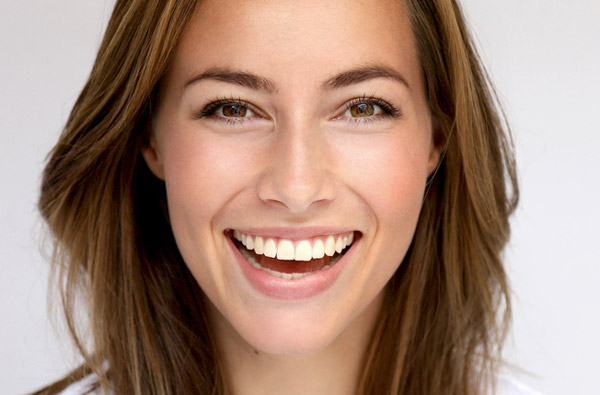 Woman smiling with perfect teeth after visiting the oral hygiene center at Gwinnett Dental Implant and Periodontal Center in Lilburn, GA